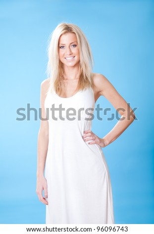 Portrait of beautiful young woman in summer dress on sky background - stock photo