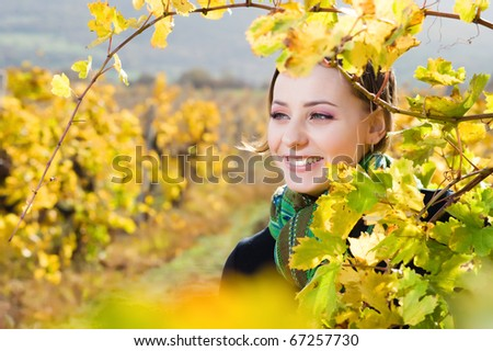 Portrait of beautiful young woman in vineyard - stock photo