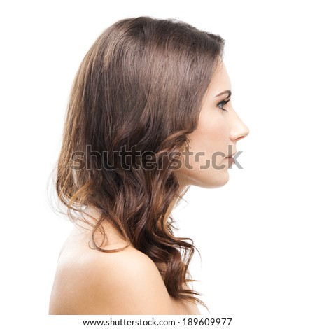 Portrait of beautiful young woman, isolated over white background - stock photo