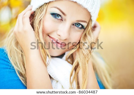 Portrait of beautiful young woman  outdoors in autumn - stock photo