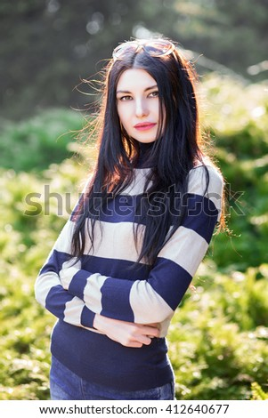 Portrait of beautiful young woman posing outdoors - stock photo