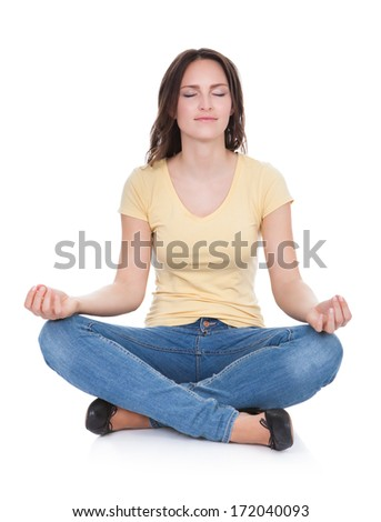 Portrait Of Beautiful Young Woman Practicing Yoga Over White Background - stock photo