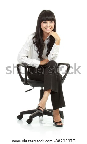 Portrait of beautiful young woman sitting on chair isolated over white background - stock photo
