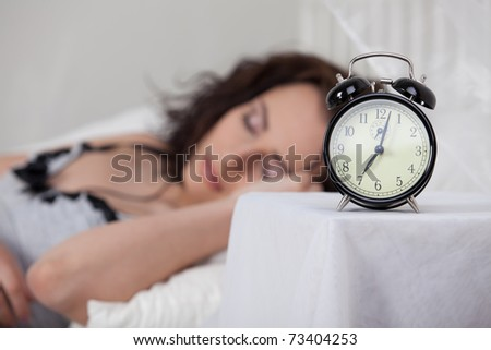 Portrait of beautiful young woman sleeping in bed at home. - stock photo