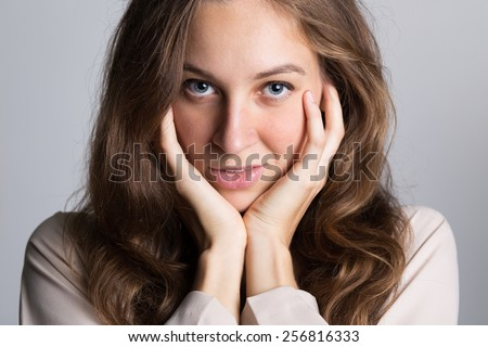 Portrait of Beautiful Young Woman Smiling - stock photo