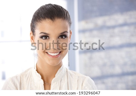 Portrait of beautiful young woman smiling happily. - stock photo