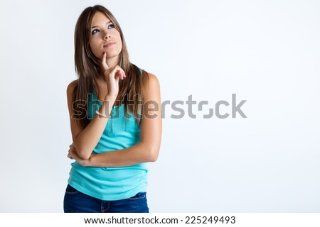 Portrait of beautiful young woman thinking. Isolated on white.  - stock photo