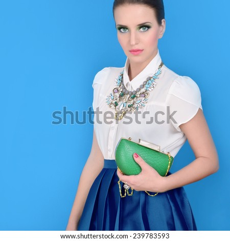 Portrait of beautiful young woman with bag.Fashion photo of beautiful woman - stock photo