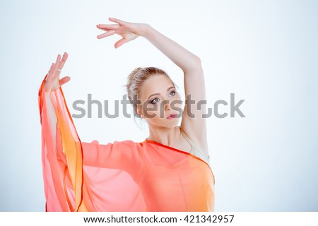 portrait of beautiful young woman with blond hair. graceful   dancer in yellow dress - stock photo
