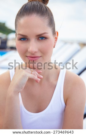 Portrait of beautiful young woman with blue eyes - stock photo
