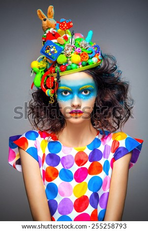 Portrait of beautiful young woman with creative pop art makeup - stock photo