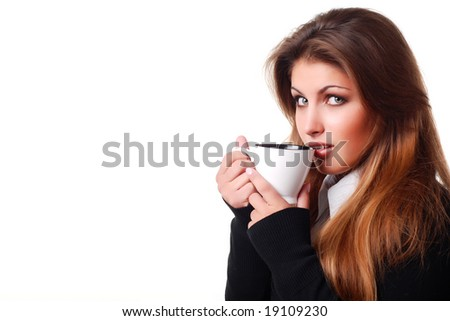 portrait of beautiful young woman with cup of coffee - stock photo