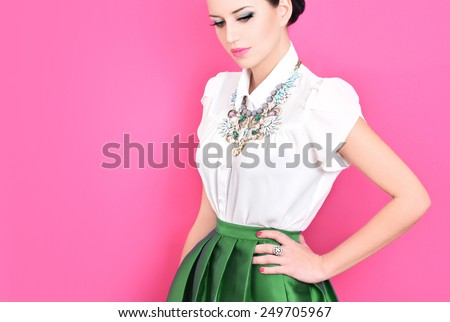Portrait of beautiful young woman with fashion jewelry - stock photo