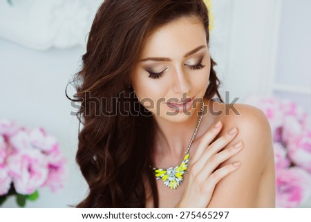Portrait of Beautiful Young Woman with Flowers. Healthy Long Hair and Clear Skin. Close Up - stock photo