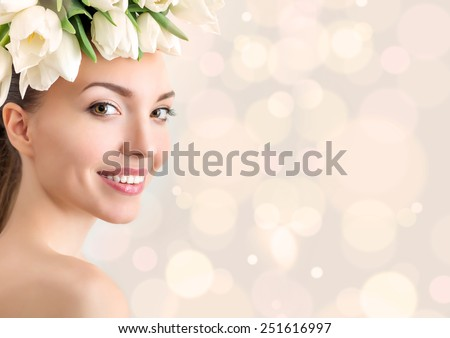 Portrait of beautiful young woman with flowers in hair. Bokeh, color toning. Place for text - stock photo