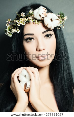 Portrait of Beautiful Young Woman with Flowers. Perfect Makeup and Skin.  - stock photo