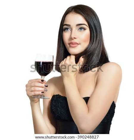 Portrait of beautiful young woman with glass of wine, over white background - stock photo