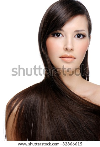 portrait of beautiful young woman with luxuriant healthy long hair - stock photo