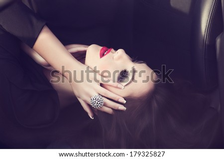 Portrait of beautiful young woman with makeup and with jewelry precious decorations. - stock photo