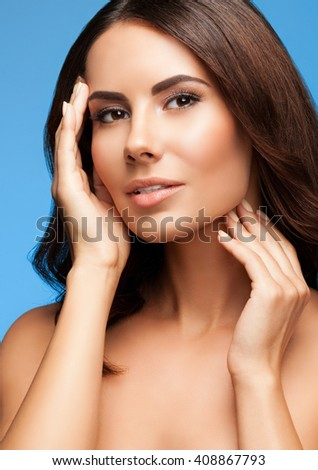 portrait of beautiful young woman with naked shoulders, on blue background, with blank copyspace area for slogan or text message - stock photo