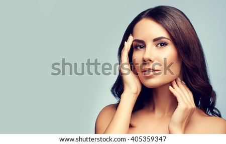 portrait of beautiful young woman with naked shoulders, with copyspace area for slogan or text - stock photo
