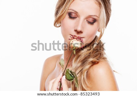 portrait of beautiful young woman with rose on white - stock photo