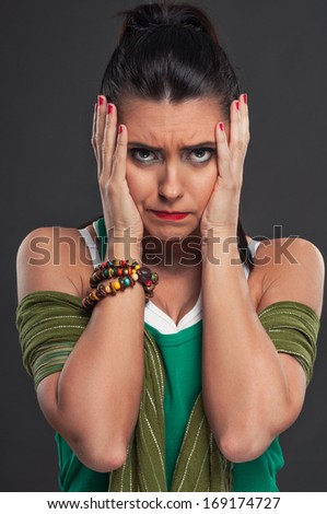 Portrait of beautiful young women who has a problem - stock photo