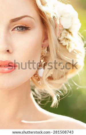 Portrait of beauty bride with flowers in hair - stock photo