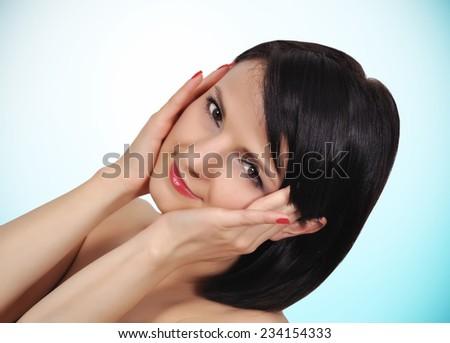 Portrait of beauty girl on a blue background - stock photo