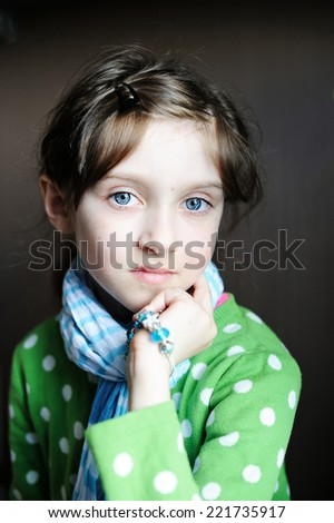Portrait of  beauty kid girl in the blue scarf indoor - stock photo