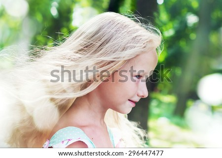 Portrait of Beauty Little Girl with Blonde Hair in Summer Park - stock photo
