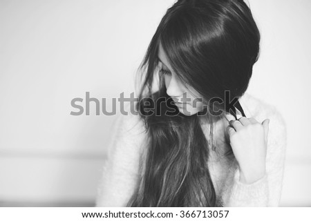Portrait of beauty school aged  brunette kid girl  with blue eyes indoor in black and white edition - stock photo