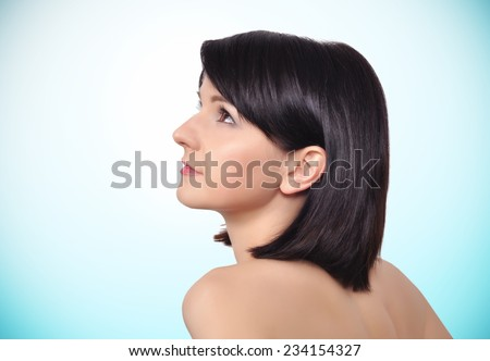 Portrait of beauty woman on a blue background - stock photo