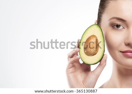 Portrait of beauty woman with avocado - stock photo