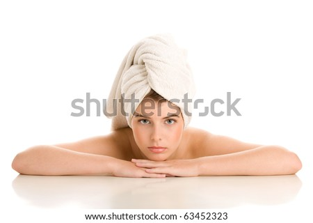 Portrait of beauty woman with head wrapped towel - stock photo