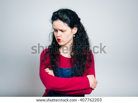 Portrait of beauty young woman with arm crossed and looking strong - stock photo