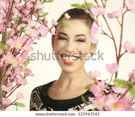 portrait of beauty young woman with flower close up like geisha make up - stock photo