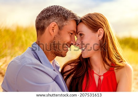 portrait of beloved couple enjoying warmer autumn days  - stock photo