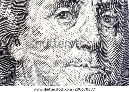 Portrait of Benjamin Franklin on one hundred dollar bill close-up. - stock photo