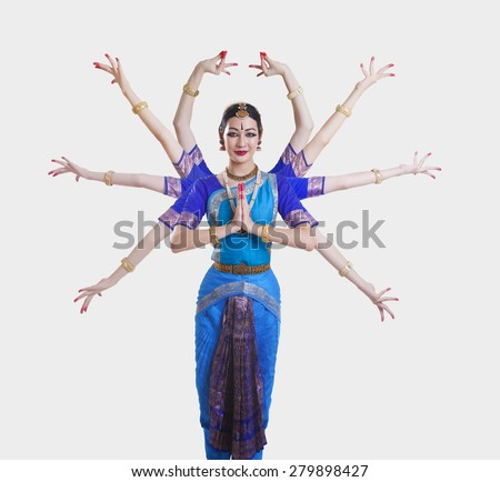 Portrait of Bharatanatyam dancer with multiple mudras over white background - stock photo