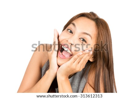 Portrait of blissful, euphoric Asian woman, light brown hair in sleeveless clothes, face cupped, head in hands reacting positively to happy news or information. Thai national of Chinese origin - stock photo