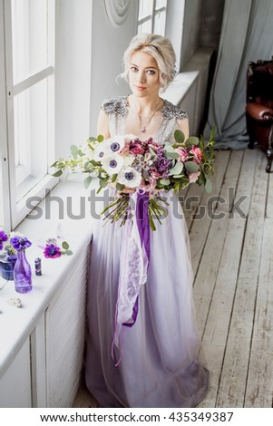 Portrait of blond bride with a bouquet - stock photo