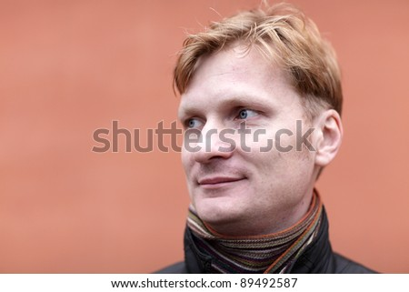 Portrait of blond on the red background - stock photo