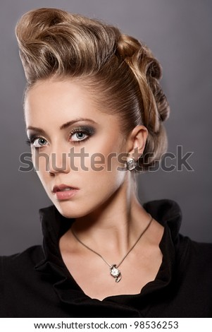 Portrait of  blond woman with fashion hairstyle - stock photo