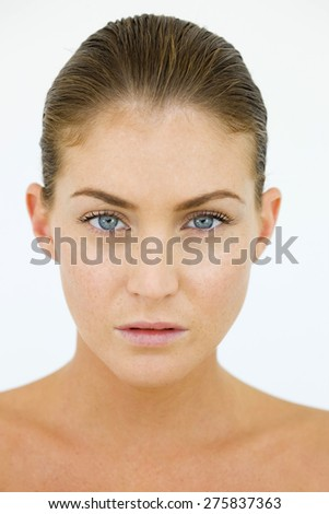 Portrait of blond young woman. - stock photo