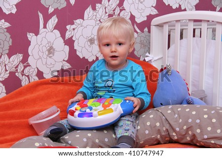 Portrait of blonde baby boy at home - stock photo