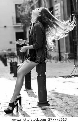 Portrait of blonde girl moving her amazing long hair - stock photo