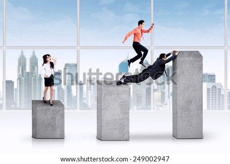 Portrait of bossy businesswoman gives orders to her employess on business graph - stock photo