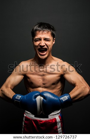 Portrait of  boxer in the dark screaming - stock photo