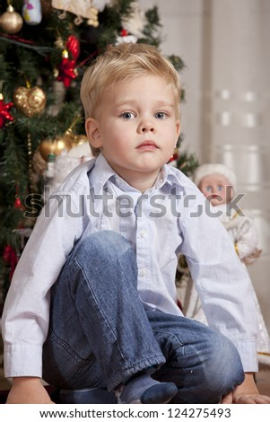 Portrait of Boy in shirt at christmas time - stock photo